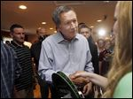 Ohio Gov. John Kasich, one in a crowded field of GOP presidential candidates, shakes hands after speaking at a stop in Derry, N.H. He held a town hall on Wednesday.