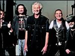 Grand Funk Railroad drummer Don Brewer, center, with his bandmates.