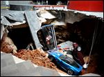 A sinkhole opened up swallowing eight classic and historic Corvettes at the National Corvette Museum in Bowling Green, Ky.  in February, 2014.