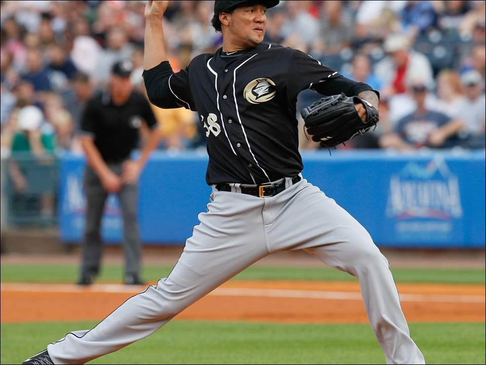 Charlotte Knights pitcher Hector Noesi throws against the Toledo Mud Hens.