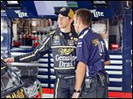 Brad Keselowski speaks with his staff in the garage during the first day of the NASCAR Sprint Cup Pure Michigan 400 at Michigan International Speedway. Keselowski said it wasn't his right to comment on the changes.