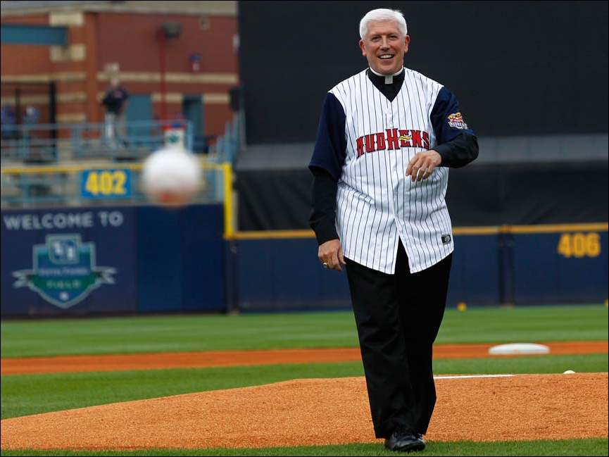 Bishop Daniel Thomas throws the first pitch before game against the Gwinnett Braves at Fifth Third Field.