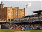 Mud Hens fans watch as Toledo pitcher Thad Weber (32) throws against the Louisville Bats at Fifth Third Field in July.
