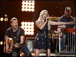 Dierks Bentley, left, and Ashley Monroe perform at ACM Presents Superstar Duets at Globe Life Parkin Arlington, Texas.