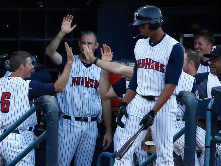 Toledo Mud Hens batter Josh Wilson is met in the dugout after hitting a home run against Gwinnett.