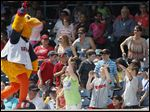 Muddy the Mud Hen entertains school kids between innings at Fifth Third Field.