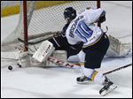Carolina Stingray goalie Jeff Jakaitis makes a save against Toledo Walleye's Shane Berschbach during Game 7 in the ECHL Eastern Conference hockey finals in May.