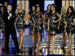 FILE  In this Sunday, Sept. 14, 2014 file photograph, television personality Chris Harrison, left, talks during the Miss America 2015 pageant, Sunday, Sept. 14, 2014, in Atlantic City, N.J. On Thursday, Aug. 20, 2015, the Miss America Organization announced that Harrison of ABC's