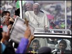 Pope Francis waves from his popemobile as he arrives to celebrate Mass at Bicentennial Park in Quito, Ecuador last month.