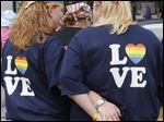 Sarah Wyatt, left, and Karen Cheatham, both of Oregon, wait for last year's Toledo Pride parade.