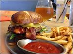 The Pineapple Express burger from Two Foxes in Bowling Green includes bacon and pineapple and a Hot Blonde beer.