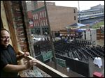 Assistant general manager of Ye Olde Durty Bird KC Saint John looks at Fifth Third Field from 28 N. St. Clair St.