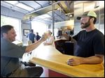 Kelly Wicks, left, and Justin Marx, brewer and owner, share a beer during the soft opening of his new craft brewery called Bowling Green Beer Works in Bowling Green.