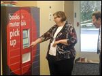 Lisa Green, Oregon Branch Library manager, gives a tour of the renovated facility, which includes a lobby open 24/7 where people can pick up ordered books from a secure locker.
