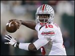 Ohio State quarterback J.T. Barrett looks to pass against Michigan State in East Lansing, Mich. Barrett is competing with Cardale Jones to be the No. 1 quarterback on the team.