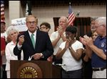 Former Ohio Governor Ted Strickland, at podium, who is running for U.S. Senate, is endorsed by the UAW during an announcement at UAW Local 12 Hall in Toledo Tuesday.