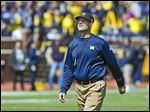 Coach Jim Harbaugh will look to reverse Michigan's recent fortunes after a 5-7 record last season.
