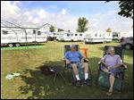 Garry and Carol Chamberlin relax in the shade by their camper at the Fulton County Fairgrounds.