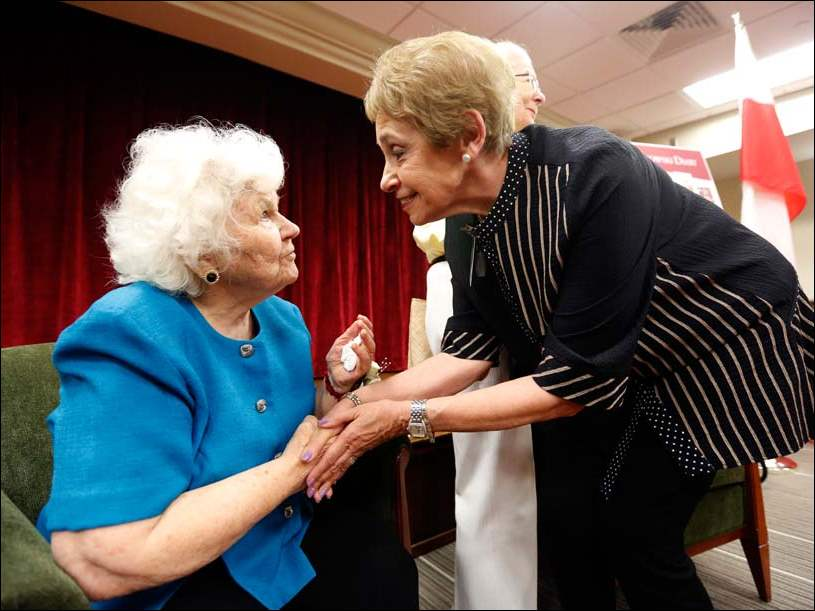 Elizabeth Frankowski, left, 88, and Sheila Odesky, right, President to the Toledo-Lucas County Public Library Board of Trustees, greet each other during a reception to honor Mrs. Frankowski.