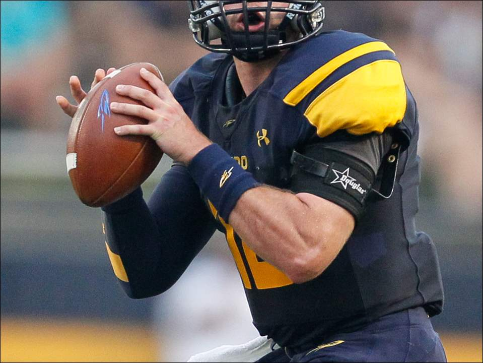 University of Toledo QB Phillip Ely (12) looks to throw against Stony Brook on Thursday at the Glass Bowl.