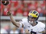 Michigan quarterback Jake Rudock throws a pass in the first quarter against Utah.