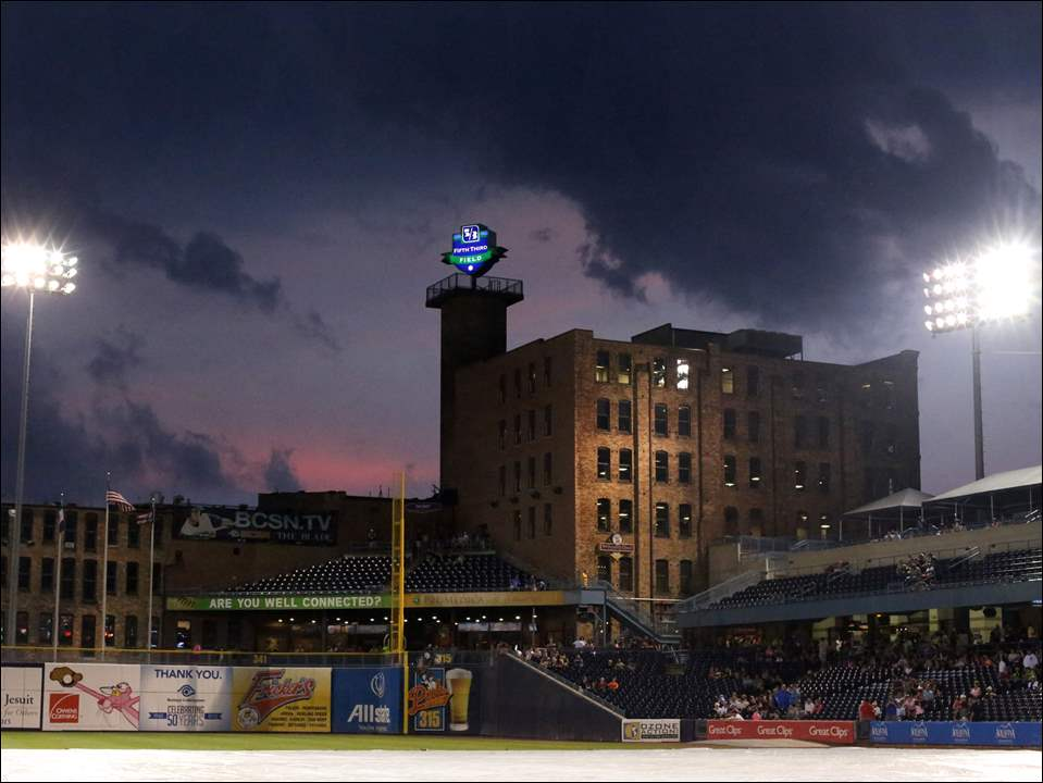 Clouds gather above the ball park in the bottom of the fifth inning during the Thursday, September 3, 2015, match up against the Louisville Bats at Fifth Third Field in downtown Toledo. The game was weather delayed in the bottom of the fifth inning.
