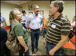 Democratic presidential candidate Martin O'Malley, center, a former governor of Maryland, talks with residents during a meet-and-greet session in  Indianola, Iowa, last month.
