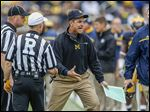Michigan head coach Jim Harbaugh loses his cool with referees during Saturday's game against Oregon State at Michigan Stadium.