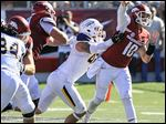 Arkansas quarterback Brandon Allen is hit by Toledo's Trent Voss during the second quarter Saturday in Little Rock.