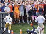 Virginia fans react as Notre Dame's Will Fuller scores on a 40-yard touchdown catch from DeShone Kizer with only 12 seconds left on Saturday in Charlottesville, Va.