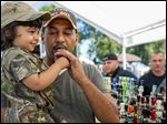 A father and his child test out a duck call at a previous Pointe Mouillee Waterfowl Festival. The 68th annual Pointe Mouillee Waterfowl Festival will be Saturday and Sunday.