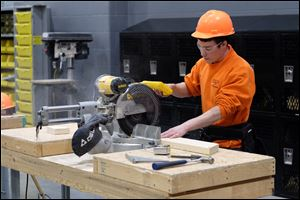 A Penta Career Center student uses a circular saw on a project in the school's construction carpentry program.
