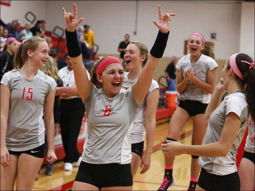 Bowling Green's Mackenzie Dunn (6) celebrates defeating Perrysburg during a volleyball match Tuesday.
