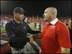 Tony Sanchez, right,  coached at a top high school program in Las Vegas before taking over at UNLV.