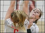 Perrysburg's Shelby Fulmer spikes the ball by Bowling Green's Mackenzie Dunn.