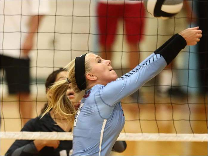 Eastwood's Abigail Schroeder (5) returns a serve against Otsego during a volleyball game Thursday in Pemberville