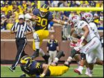 Michigan running back Drake Johnson runs through UNLV's defense Saturday in Ann Arbor. The Wolverines racked up 377 total yards, which included 254 on the ground by 10 different runners. Johnson finished with five carries for 28 yards.