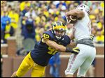 Michigan linebacker Ben Gedeon tackles UNLV tight end Jake Phillips on Saturday in Ann Arbor.