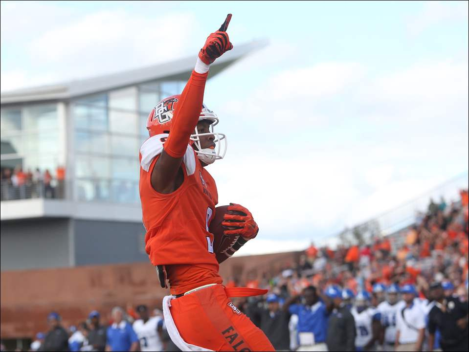 Bowling Green State University's Teo Redding (9) celebrates his touchdown during the second quarter of the Saturday, September 19, 2015, match up against the University of Memphis at the Doyt L. Perry Stadium in Bowling Green. The Falcons led the Tigers going into the half, 27-17.