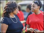 Mayor Paula Hicks-Hudson, left, speaks with volunteer Shawntae McIntish during a campaign rally at Dorr St. andUpton Ave. Ms. Hicks-Hudson isone of seven candidates running for mayor in November.