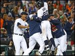 Detroit Tigers' Rajai Davis (20) celebrates his game winning one-run single.