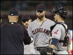 Cleveland Indians pitcher Corey Kluber, center, hands over the ball to manager Terry Francona as he is pulled after giving up four runs.