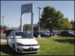 Volkswagens are on display on the lot of a dealership in Boulder, Colo. Volkswagen is reeling days after it became public that the German company had rigged diesel emissions to pass U.S. tests. The CEO has resigned over the scandal.