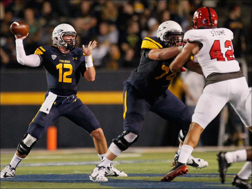 University of Toledo QB Phillip Ely (12) throws the ball against Arkansas State.