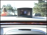 A car with a wireless data device to alert a driver of hazards in Ann Arbor, Mich., Aug. 21, 2012. Federal regulators on Tuesday announced the launch of a year-long