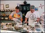 Associates Rory Turnbull, left, and Chris Hewitt prepare bags of marijuana buds for sale at the Nature Scripts medical marijuana dispensary in Murphy, Ore., Wednesday, Sept. 30, 2015.