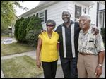 CTY  bellxx     09/28/2015   Toledo mayoral candidate Mike Bell, center, with his parents Ora and Norman Bell, in front of his parent's Stickney Ave. home in Toledo, Ohio. The Blade/Lori King
