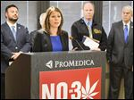 Wendy Gramza, president of the Toledo Regional Chamber of Commerce, expresses opposition to State Issue 3, during a news conference Monday.   Behind her from left are Arturo Polizzi, president of ProMedica Toledo Hospital, Dr. Bruce Barnett (hidden), Gary Siesel of the Industrial Union of Operating Engineers, and State Senator Randy Gardner.
