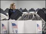 Toledo mayoral candidate Sandy Drabik Collins casts her ballot at the Early Voting Center on its opening day Tuesday.
