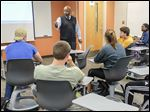 Maurice Washington leads his life planning class at Bowling Green State University. He says 60 percent of his students are able to choose a major by the course's end.